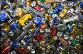 Different cans for recycling into a container — Stock Photo