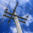 Power lines for power pole electricity grid — Stock Photo #69745959