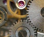 Metallic Background with metal cogwheels a clockwork. Macro  — Stockfoto