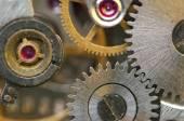 Fondo con ruedas dentadas de metal de un mecanismo de relojería. fotografía conceptual — Foto de Stock