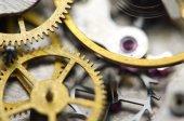 Background with golden metal cogwheels inside clockwork — Stock Photo