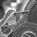achtergrond met metalen tandwielen een uurwerk. macro — Stockfoto #69118807