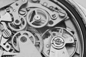 Black and white macro photo metal clockwork — Stock Photo