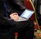 Businessman on conference with ultrabook — Foto Stock