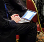 Businessman on conference with ultrabook — Stock Photo
