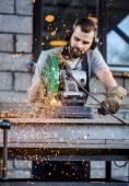 Industrial worker cutting metal — Stock Photo