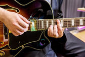 Guitarist playing in jazz band — Stock Photo