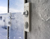 Frozen castle on glass doors — Stock Photo