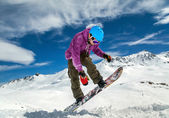 Snowboarder in mountains — Stock Photo