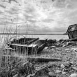 Old wooden fishing boat on lake coast — Stock Photo #68961947