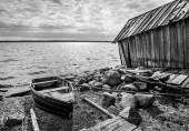 Old wooden fishing boat on lake coast — Stok fotoğraf