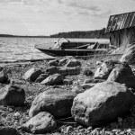 Old fishing motor boat on lake coast — Stock Photo #70153087