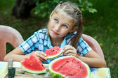 Young girl eating ripe watermelon — Stock Photo