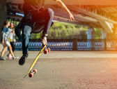 Silhouette skateboarder jumping in city — Stock Photo