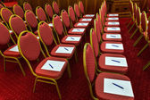 Chairs with notepads and pens in empty conference room — Stock Photo