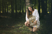 Beautiful girl and forest fairies — Stock Photo