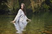 Beautiful woman in forest stream — Stock Photo