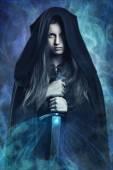 Beautiful dark woman and magic powers — Stock Photo