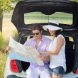Tourist couple lost in the countryside — Stock Photo #67841419