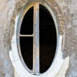 Ragged oval window in an old building — Stock Photo #67464393