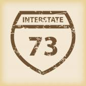 Grungy Interstate 73 icon — Stock Vector