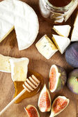 Camembert cheese with figs and honey — Stock Photo