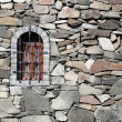 Stone wall of fortress with window — Stock Photo #52388563