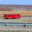 Truck with trailer goes on the highway — Stock Photo #54343355