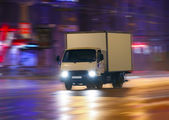 Truck moving on night city — Stock Photo