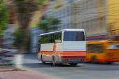 Tourist bus goes on the city — Stock Photo
