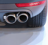 Exhaust pipe and back part of car — Stock Photo