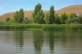 Hilly river bank — Stock Photo