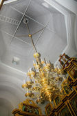 Chandelier under dome of church — Stock Photo