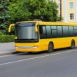 Bus goes on the city street — Stock Photo #62041905