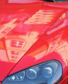 Reflections of buildings on cowl of car — Stock Photo