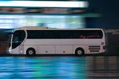 Bus moves on night city — Stock Photo