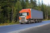 Truck moves on highway — Stock Photo