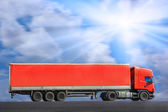 Red truck goes on way — Stock Photo