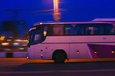 Bus moves at night — Stock Photo