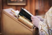 Priest's hands with bible — Stok fotoğraf