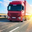 Red truck on country highway — Stock Photo #66225901
