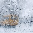Winter road through wet windshield — Stock Photo #67108523