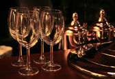 Wine glasses on bar counter — Stock Photo