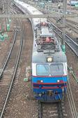 Electric locomotive with cars — Stockfoto