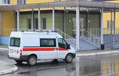 Ambulance on  parking near hospital — Stock Photo