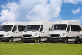 Minibuses and vans outside — Stock Photo