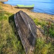 Wooden boats on bank of lake — Stock Photo #74648101