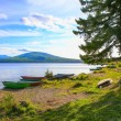 Wooden boats on bank of lake — Stock Photo #74648103