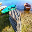Wooden boats on bank of lake — Stock Photo #75784263