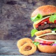 Beef burger and onion rings — Stock Photo #52472563